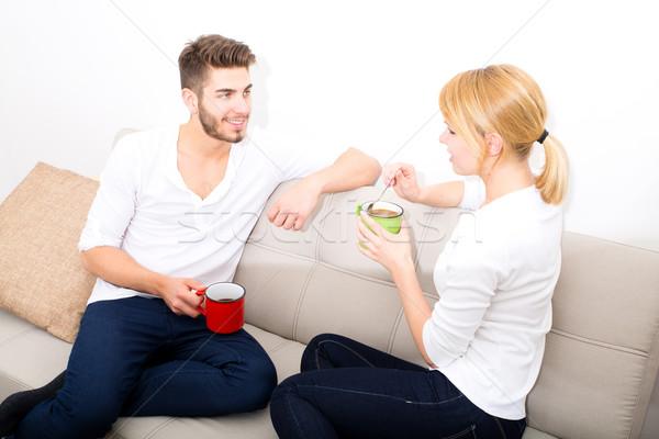 Flirtare divano donna famiglia stanza Foto d'archivio © Spectral