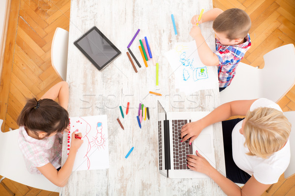 Stock photo: Mother and children with a laptop at home