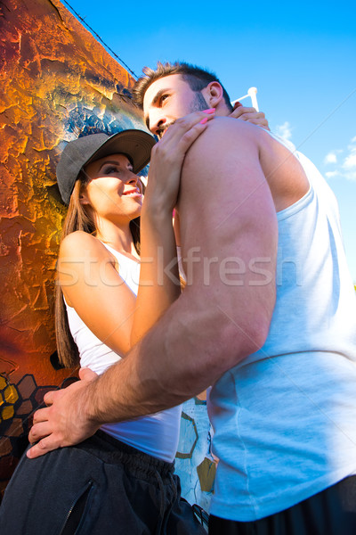 Young HipHop Couple hugging in a urban environment  Stock photo © Spectral