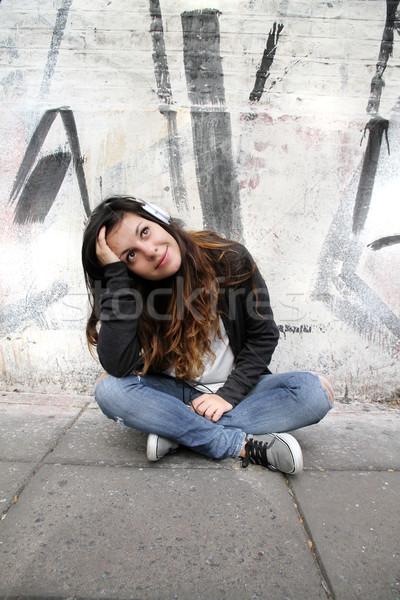 Melankolik müzik genç kadın dinleme oturma kaldırım Stok fotoğraf © Spectral