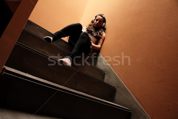 Melankolik merdiven genç kadın dinleme müzik oturma Stok fotoğraf © Spectral