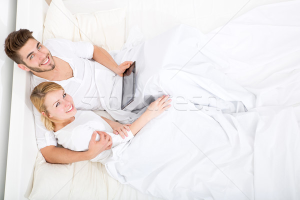 Young couple with a Tablet PC in Bed Stock photo © Spectral