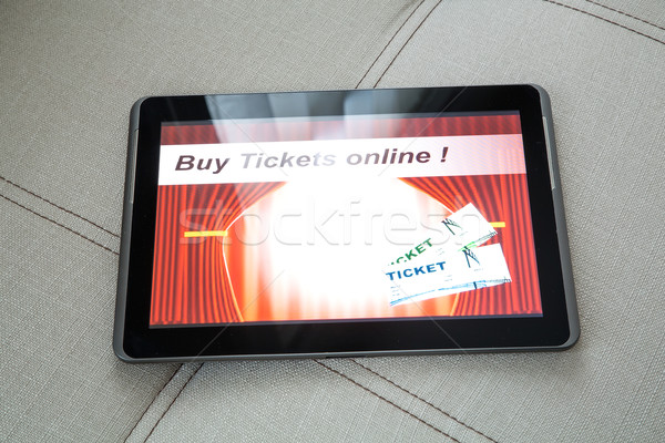 Buy Cinema Tickets online with a Tablet PC Stock photo © Spectral