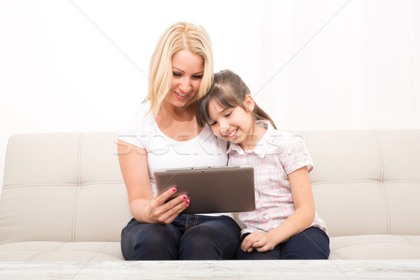 Mother with her Daughter using a Tablet PC	 Stock photo © Spectral