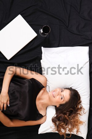 A young woman in bed Stock photo © Spectral