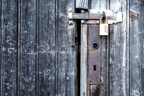 Stock photo: A locked wooden door