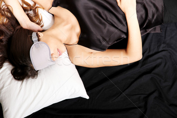 Young woman sleeping with Eyeshades Stock photo © Spectral