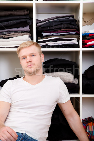 Young man with his wardrobe Stock photo © Spectral