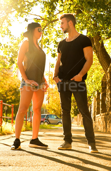 Fiatal pér beszél naplemente városi környezet beszélget Stock fotó © Spectral