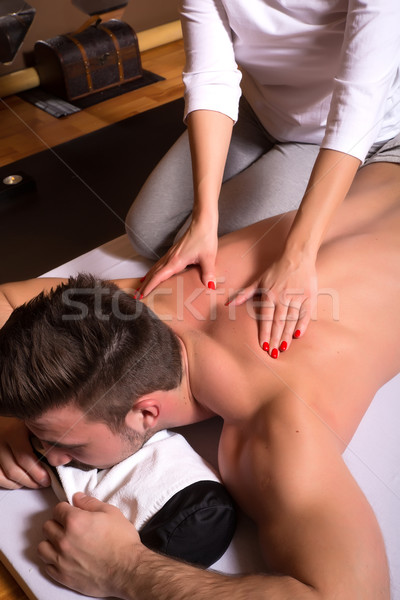 Belo jovem massagista massagem masculino Foto stock © Spectral