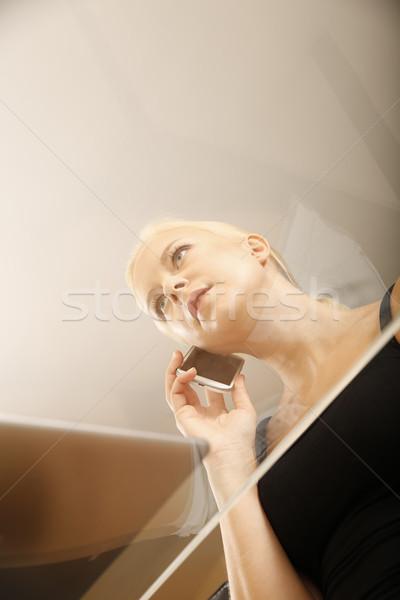 стекла девушки сидят столе телефон женщину Сток-фото © Spectral
