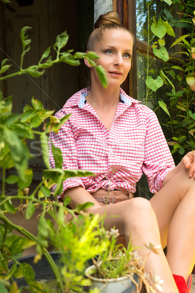 Woman sitting at her Garden shed in the summer Stock photo © Spectral
