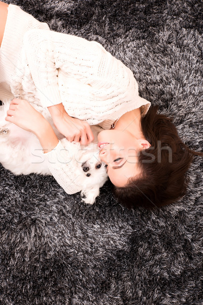 Genç güzel bir kadın köpek yavrusu iç çamaşırı halı Stok fotoğraf © Spectral
