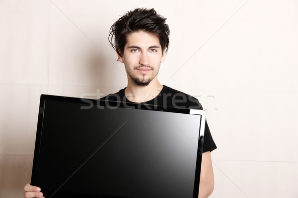 Férfi tv fiatal spanyol tart lapos kijelző Stock fotó © Spectral