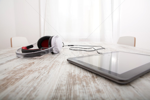 Tablet PC and headphones Stock photo © Spectral
