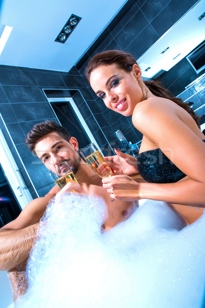 Beautiful young couple drinking Champagne in the Whirlpool Stock photo © Spectral