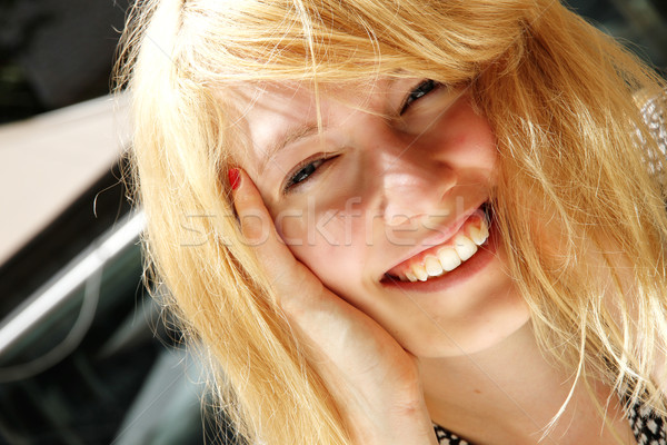 Smiling young woman in the sunlight Stock photo © Spectral