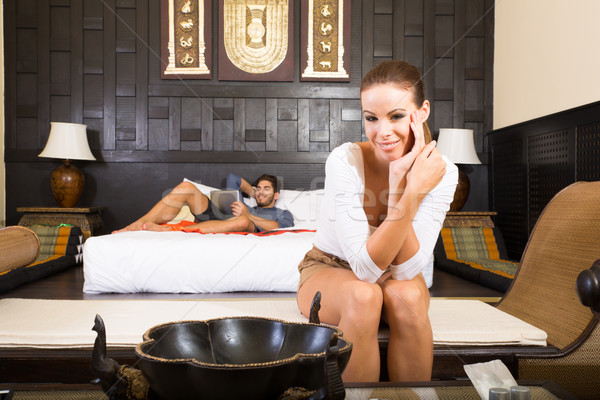 A young couple on vacations enjoying their Hotel room Stock photo © Spectral