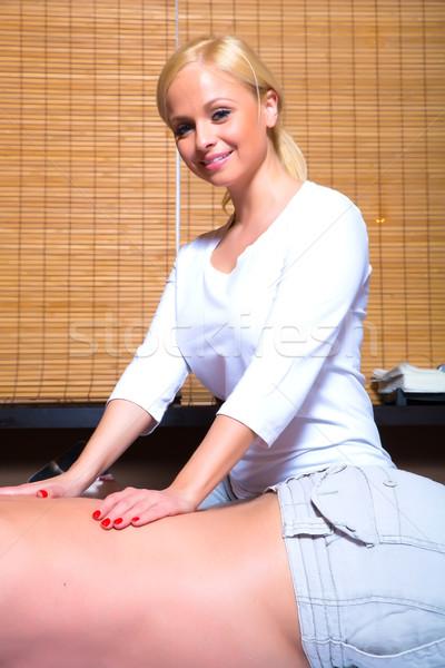 красивой молодые массажистка массаж мужчины Сток-фото © Spectral