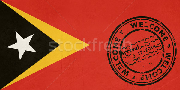 Welcome to East Timor flag with passport stamp Stock photo © speedfighter