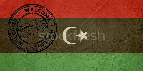 Welcome to Libya flag with passport stamp Stock photo © speedfighter