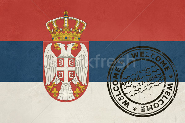 Welcome to Serbia flag with passport stamp Stock photo © speedfighter