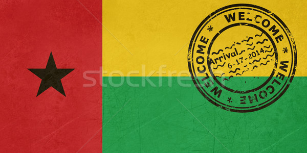Welcome to Guinea Bissau flag with passport stamp Stock photo © speedfighter