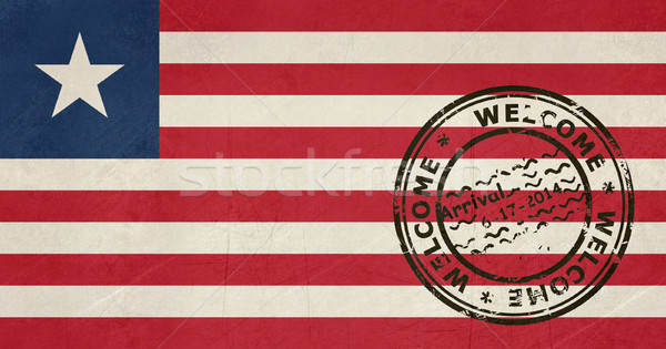 Welcome to Liberia flag with passport stamp Stock photo © speedfighter