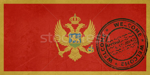 Welcome to Montenegro flag with passport stamp Stock photo © speedfighter