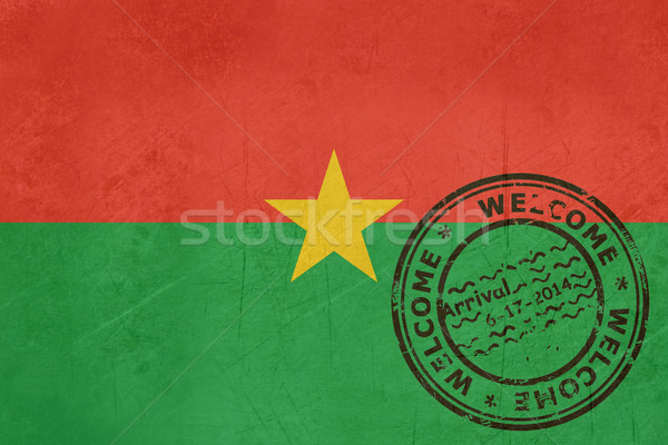 Welcome to Burkina Faso flag with passport stamp Stock photo © speedfighter