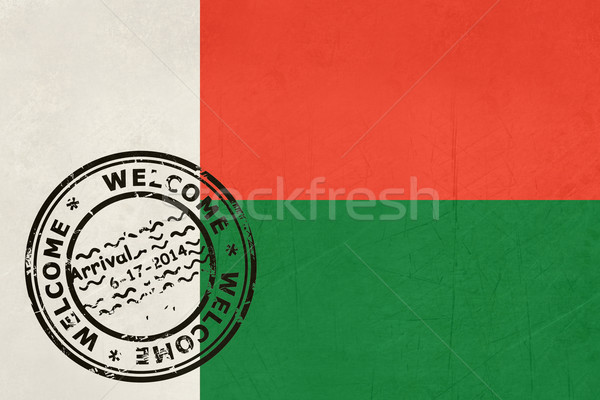 Welcome to Madagascar flag with passport stamp Stock photo © speedfighter