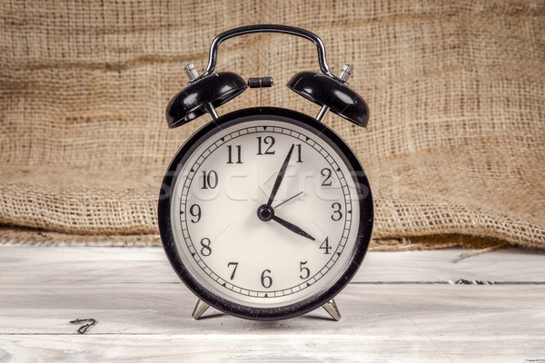 Classic alarm clock on a wooden table Stock photo © Sportactive