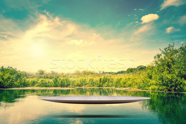 Metal stage hovering over a lake Stock photo © Sportactive