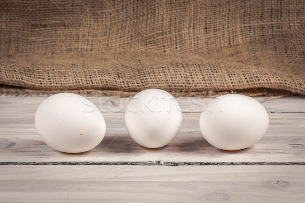 Three eggs on a wooden table Stock photo © Sportactive