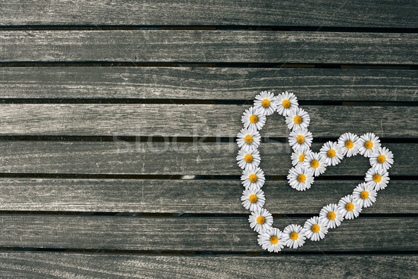 Heart made out of flowers on a wooden background Stock photo © Sportactive