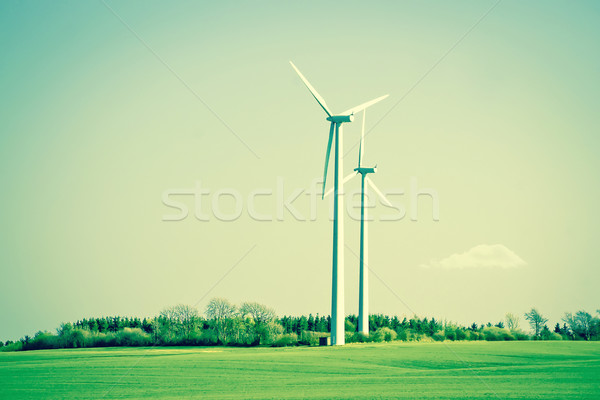 Green energy windmills in beautiful landscape Stock photo © Sportactive