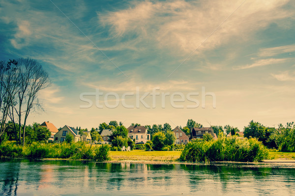 Houses by a river stream Stock photo © Sportactive