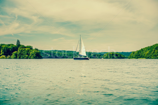 Boat with sail on a lake Stock photo © Sportactive