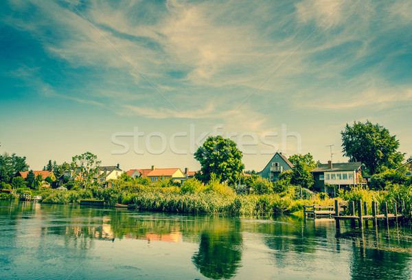 Beautiful houses by the river Stock photo © Sportactive