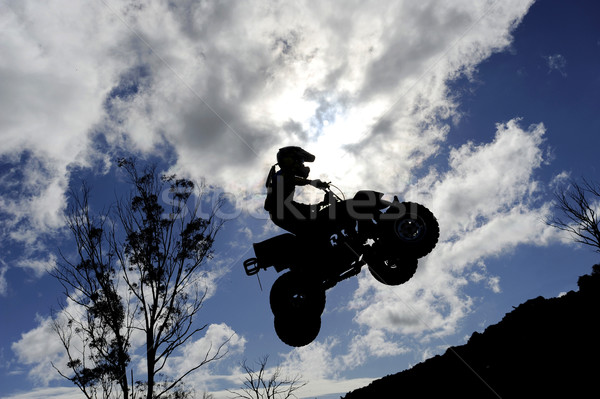 Vai silhouette bike jumping nuvoloso cielo Foto d'archivio © Sportlibrary