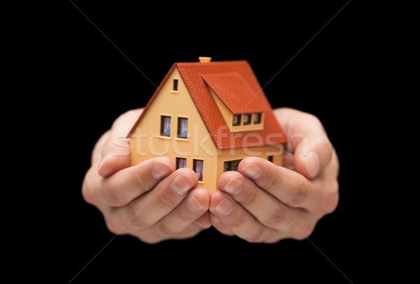 небольшой игрушку дома рук черный домой Сток-фото © sqback