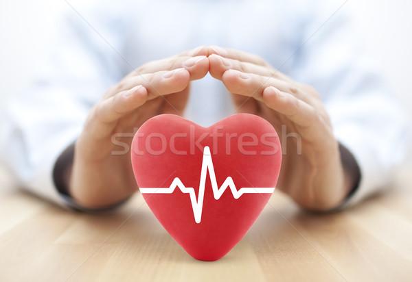 Serca puls pokryty ręce ubezpieczenie zdrowotne człowiek Zdjęcia stock © sqback
