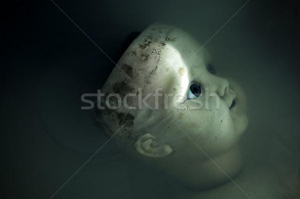 Arrepiante boneca cara escuro sujo água Foto stock © sqback