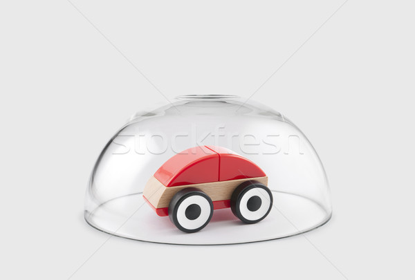 Red toy car protected under a glass dome  Stock photo © sqback