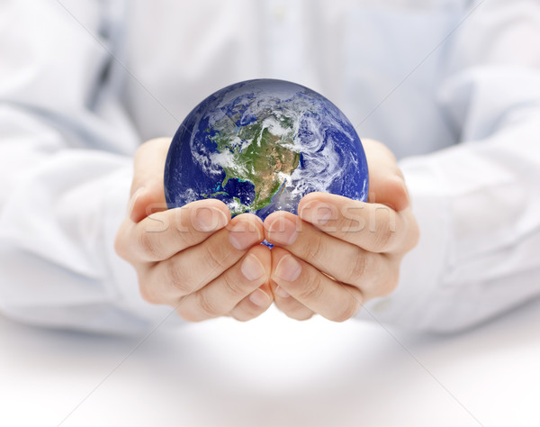 Earth in hands. Earth image provided by Nasa. Stock photo © sqback