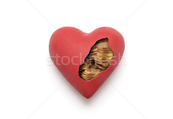 Red heart with golden coins over white background with clipping path  Stock photo © sqback