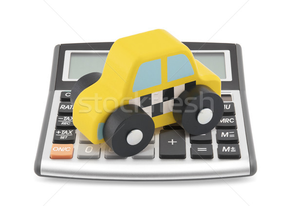 Stock photo: Calculator and taxi toy car