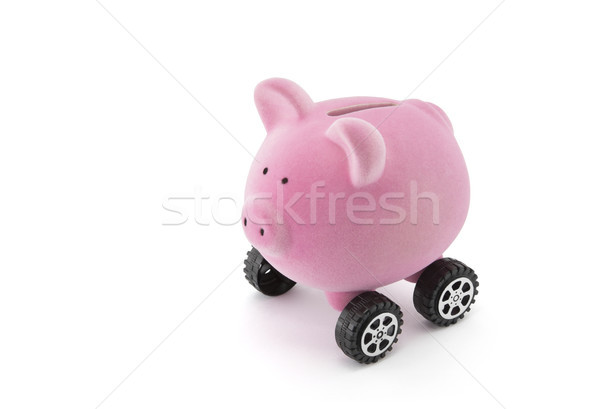 Piggy bank on wheels isolated on white with clipping path  Stock photo © sqback