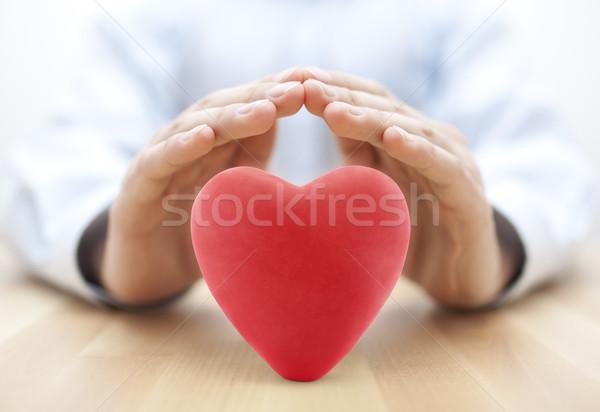 Piros szív fedett kezek egészségbiztosítás szeretet Stock fotó © sqback