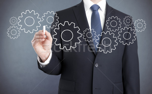 Businessman drawing gears with chalk  Stock photo © sqback